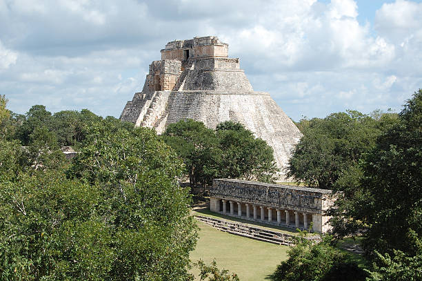 uxmal pyramid of the magician and colonnade yucatan peninsula mexico - uxmal stock photos and pictures