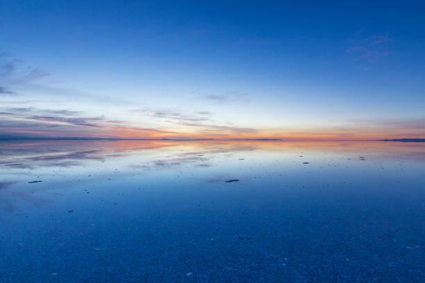 uyuni reflections, an infinite horizon - twilight stock photos and pictures