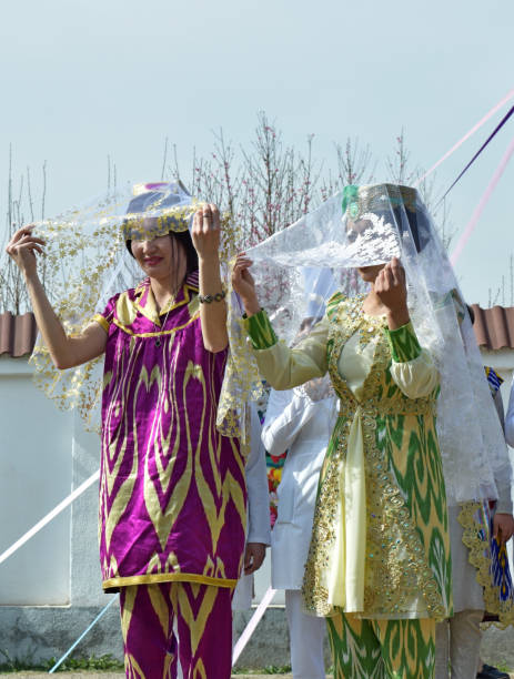 Uzbek girls dressed as brides Jizzakh, Uzbekistan, March 2019. Spring Navruz holiday.Girls in the national festive wedding dress brides in Uzbekistan muziekfestival stock pictures, royalty-free photos & images