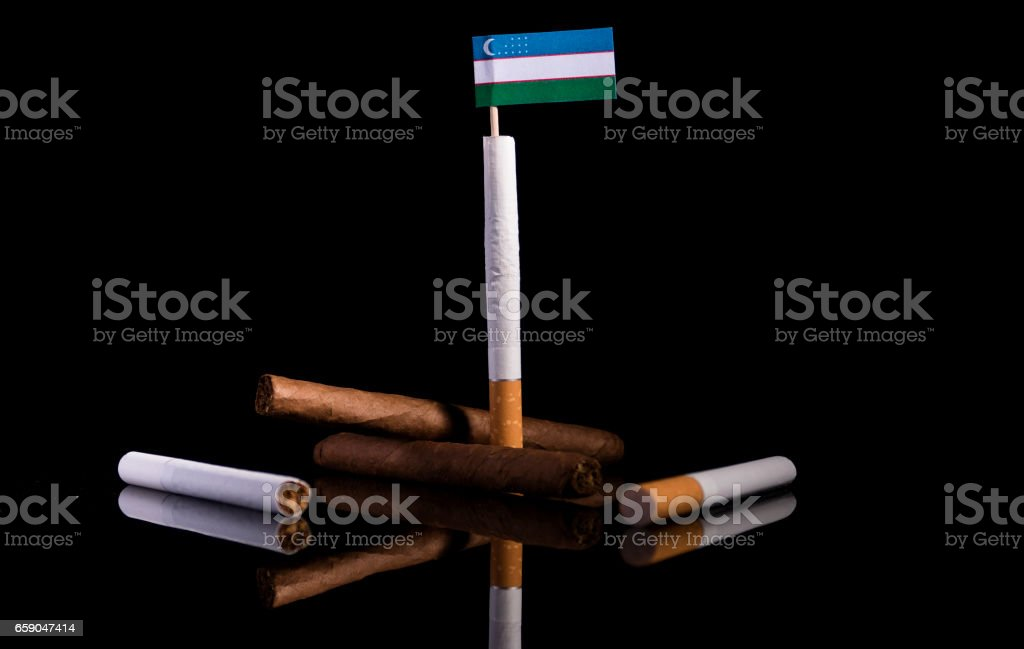 Uzbekistani flag with cigarettes and cigars. Tobacco Industry concept. royalty-free stock photo