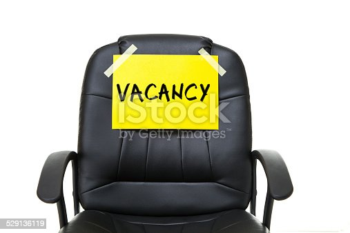 black leather office chair with yellow paper isolated on white background