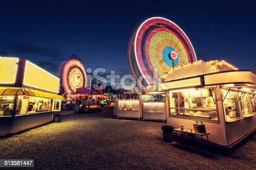A carnival spins into the night with not a soul to be found.  Long exposure.
