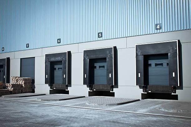 Vacant warehouse cargo doors numbered 4-8  stock photo