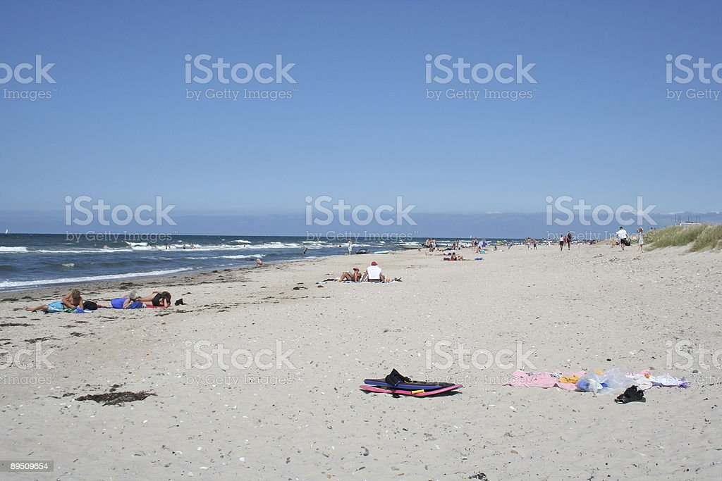 Vacation beach and people in the sun royalty-free stock photo