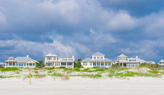 A row of vacation cottages in the sand dunes in St. Augustine, Florida.