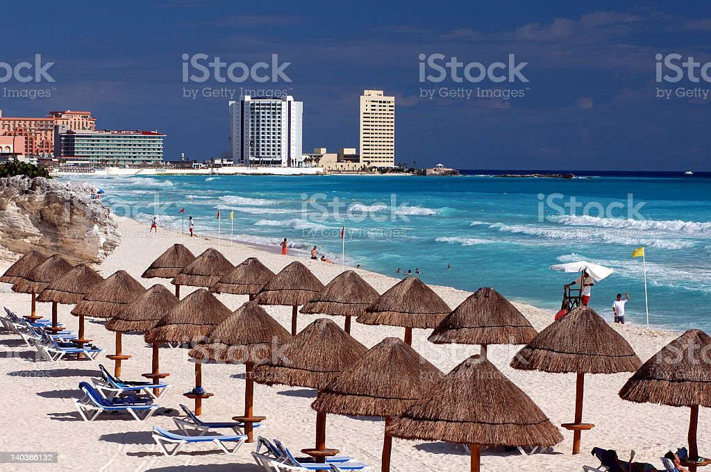 Vacation beach scene with sun chairs and umbrellas and ocean stock photo