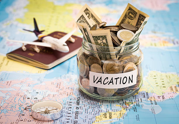 Vacation budget concept with compass, passport and aircraft toy - Photo
