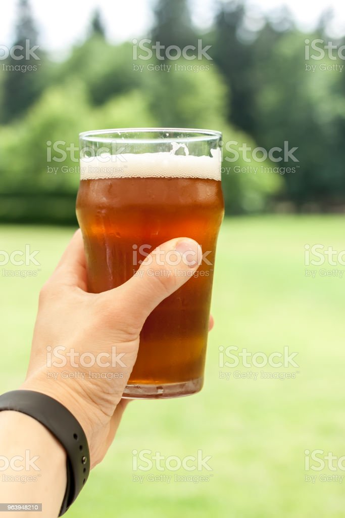 vacation concept hand with glass of beer - Royalty-free Adult Stock Photo