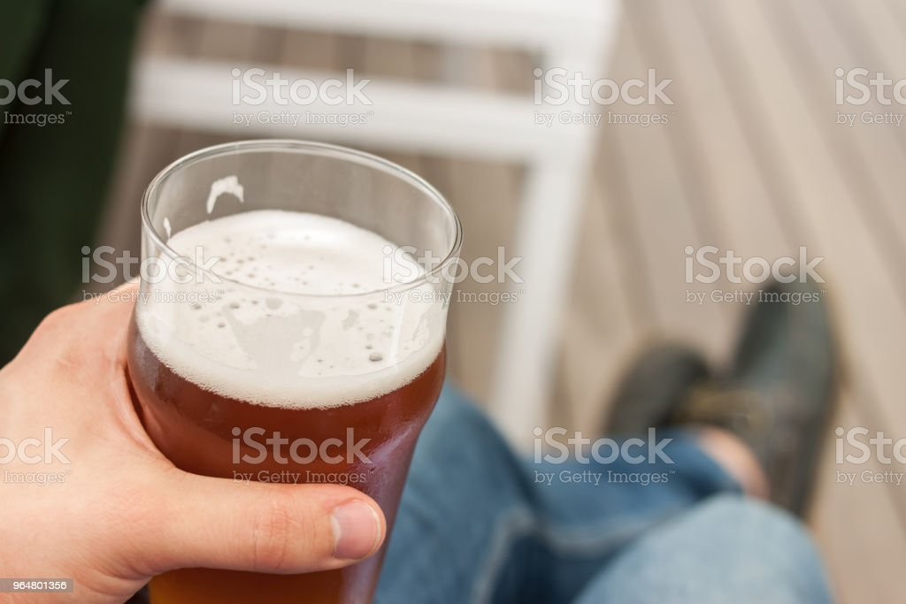 vacation concept hand with glass of beer royalty-free stock photo