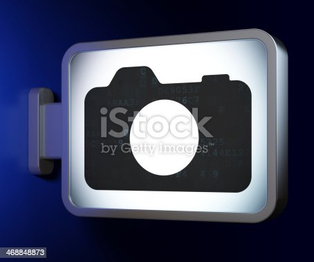istock Vacation concept: Photo Camera on billboard background 468848873