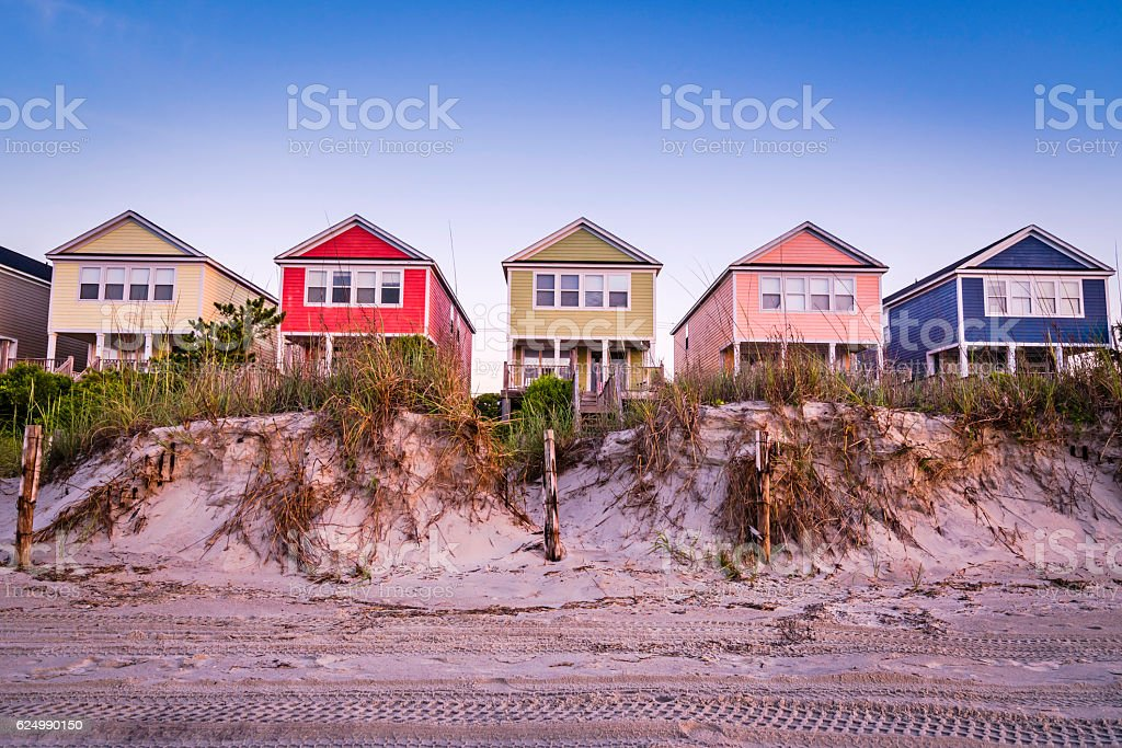Vacation cottages line the beach in summer stock photo