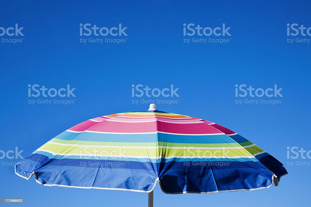 Vacation Holiday Bright beach umbrella with cool blue sky stock photo