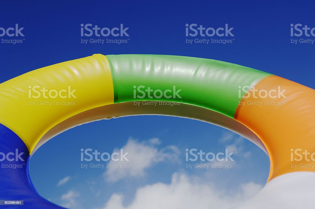 Vacation, holiday, rubber swim ring against blue sky stock photo