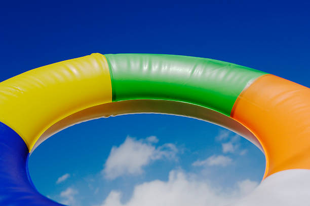vacation, holiday, rubber swim ring against blue sky - rubber ring stock pictures, royalty-free photos & images