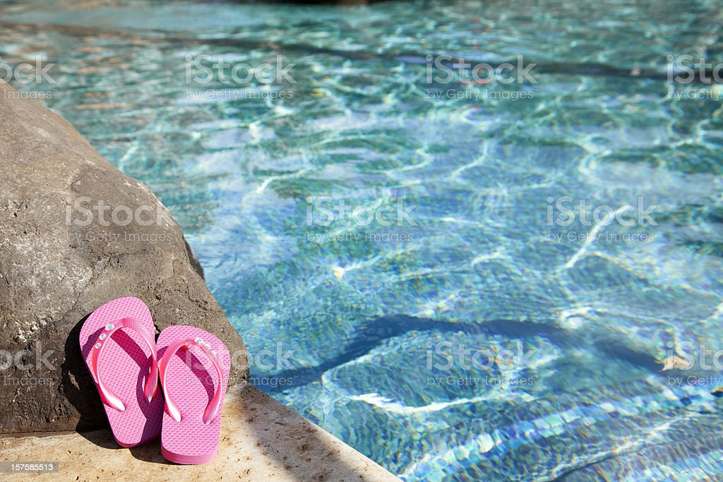 Vacation Holiday swimming pool pink flip flops sunny day water royalty-free stock photo