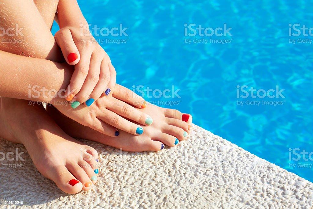 Vacation idea. Woman feet closeup. Beautiful pedicure. stock photo