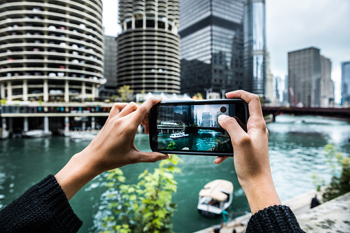 Vacation in Chicago, woman photographing city Bridges