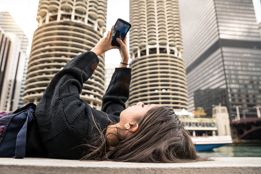 Vacation in Chicago, woman photographing the city