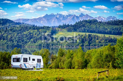 istock Vacation in Poland - camper trailer by the Czorsztyn lake and Tatra Mountains landscape 1249818265