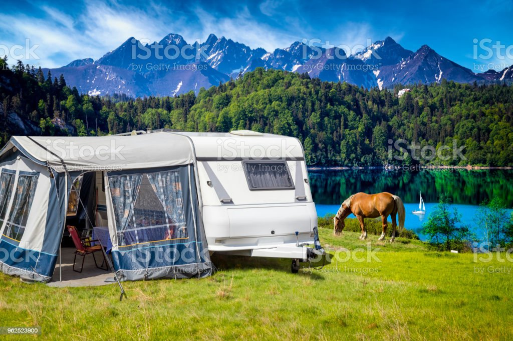 Vacation in Poland - camper trailer by the Czorsztyn lake and Tatra Mountains landscape - Royalty-free Beauty In Nature Stock Photo