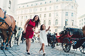 Happy mother with daughter sightseeing in Vienna