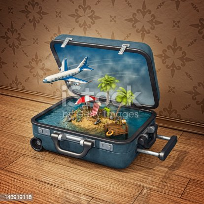 istock vacation island in suitcase 143919118