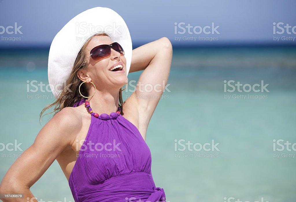 Vacation Lifestyles-Beautiful Woman Laughing at Beach royalty-free stock photo