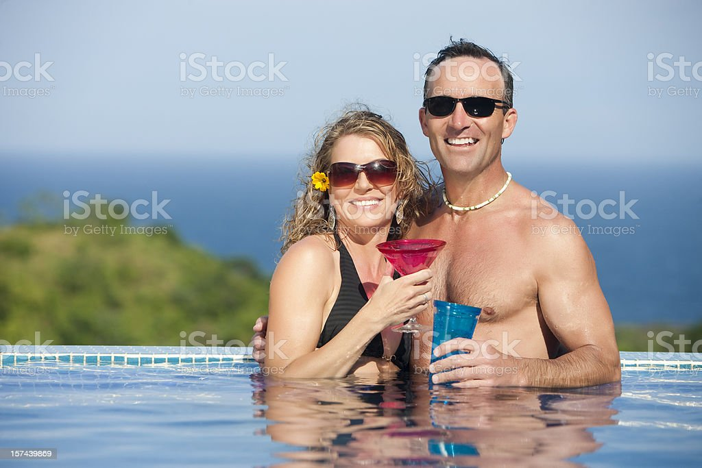 Vacation Lifestyles-Couple in Pool royalty-free stock photo