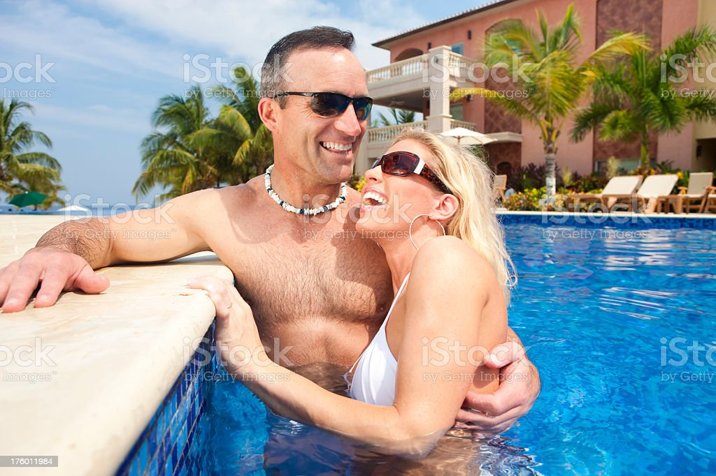Vacation Lifestyles-Couple Laughing in Pool royalty-free stock photo