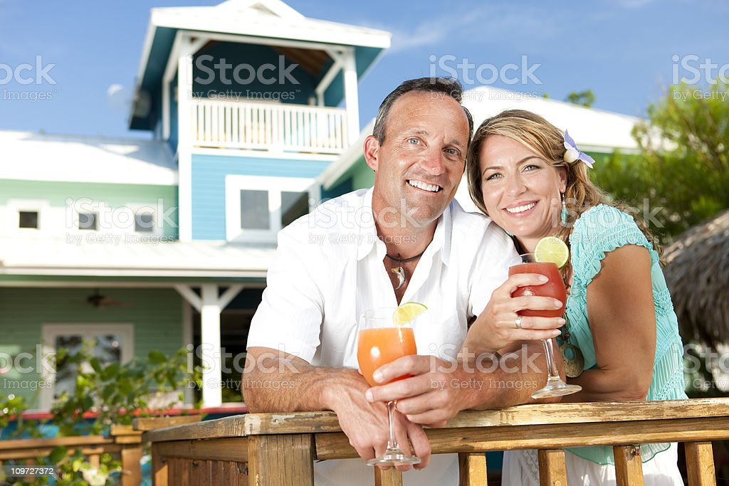 Vacation Lifestyles-Couple With Drinks at Holiday Villa royalty-free stock photo