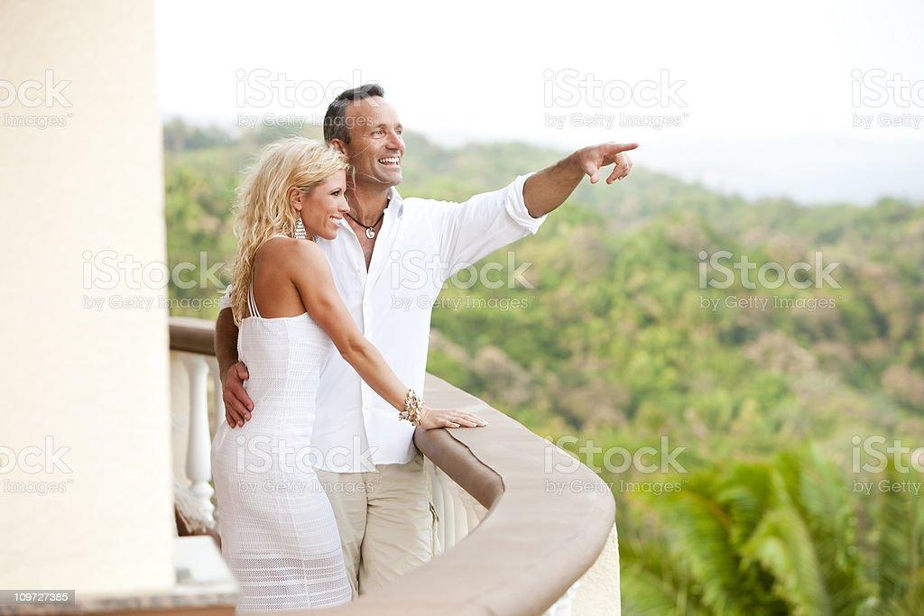 Vacation Lifestyles-Elegant Couple Enjoying the View royalty-free stock photo