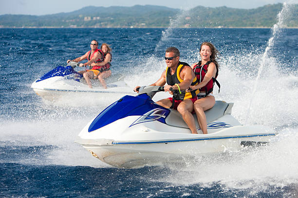 Vacation Lifestyles-Friends Riding Jet Skis Together stock photo