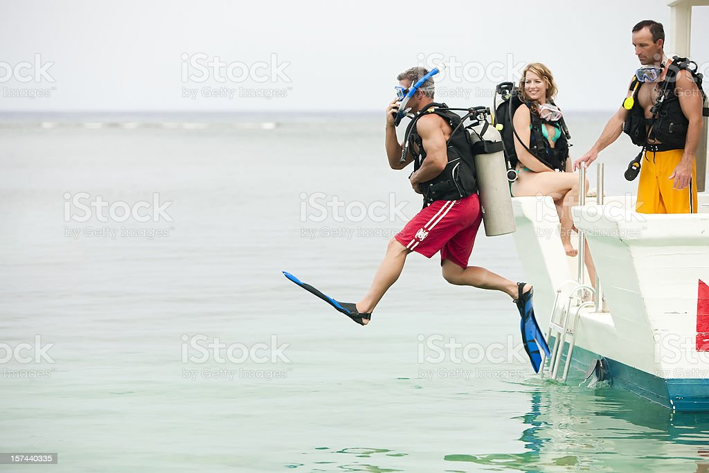 Vacation Lifestyles-Scuba Diver Jumping Off Boat stock photo