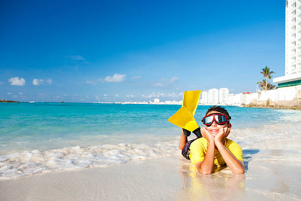 Vacation Lifestyles-Snorkeling Boy on Beach  diving flipper stock pictures, royalty-free photos & images