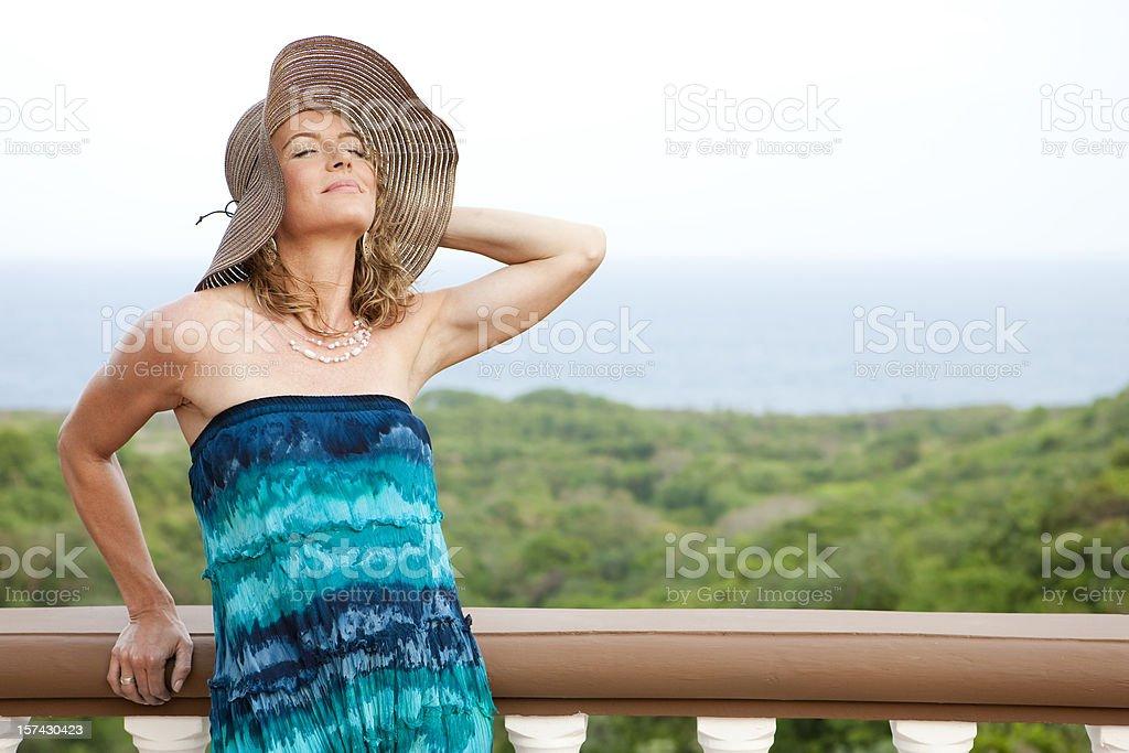 Vacation Lifestyles-Woman Enjoying the Breeze royalty-free stock photo