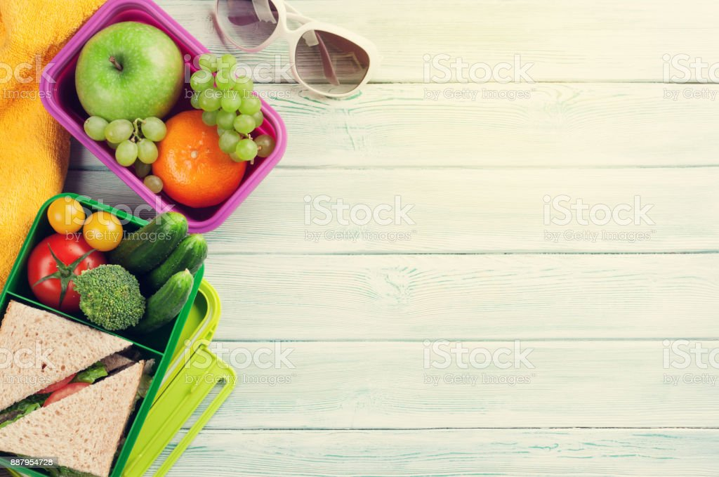 Vacation lunch box and items stock photo