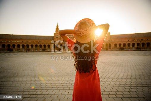 Woman enjoying sunrise above Plaza de Espana in Seville, Spain