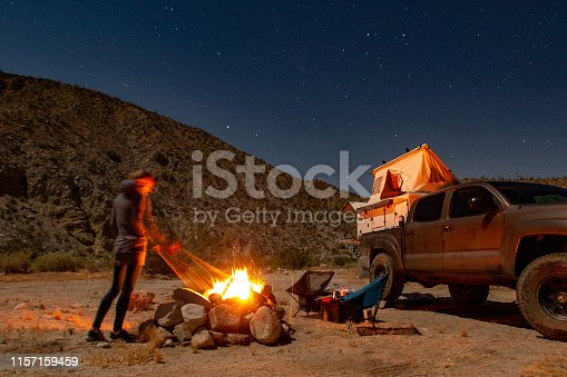 Couple enjoying a campfire on vacation