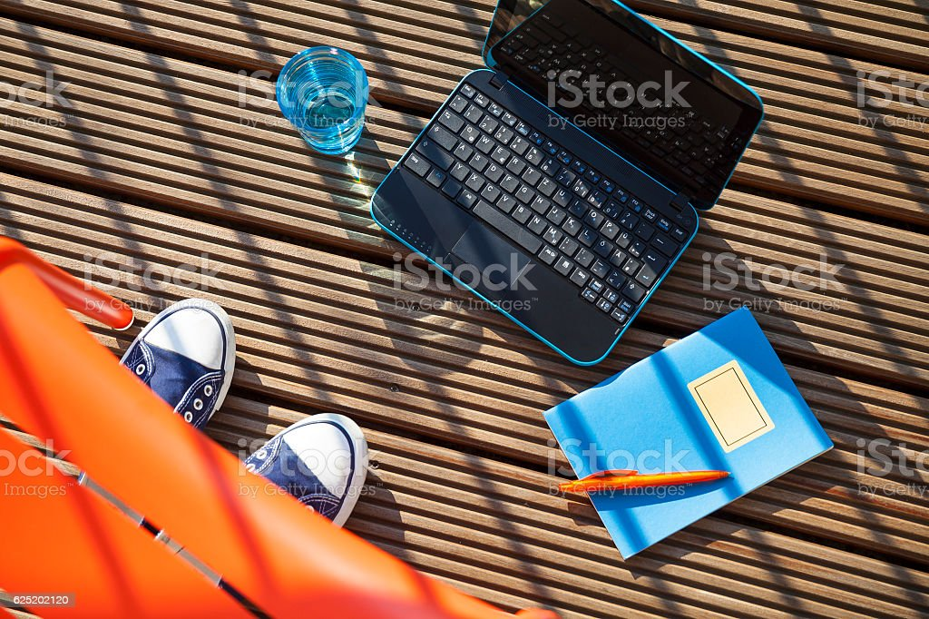 Vacation planning on the balcony stock photo