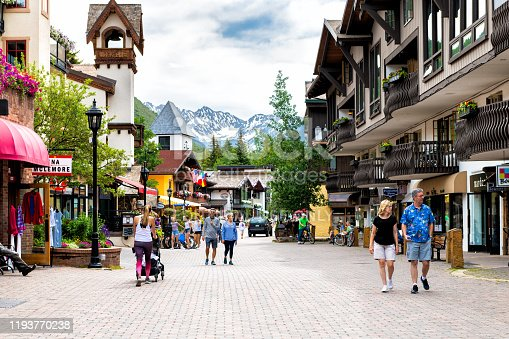 Vail, USA - June 29, 2019: Vacation resort town village in Colorado with people walking shopping by shops on Gore Creek drive