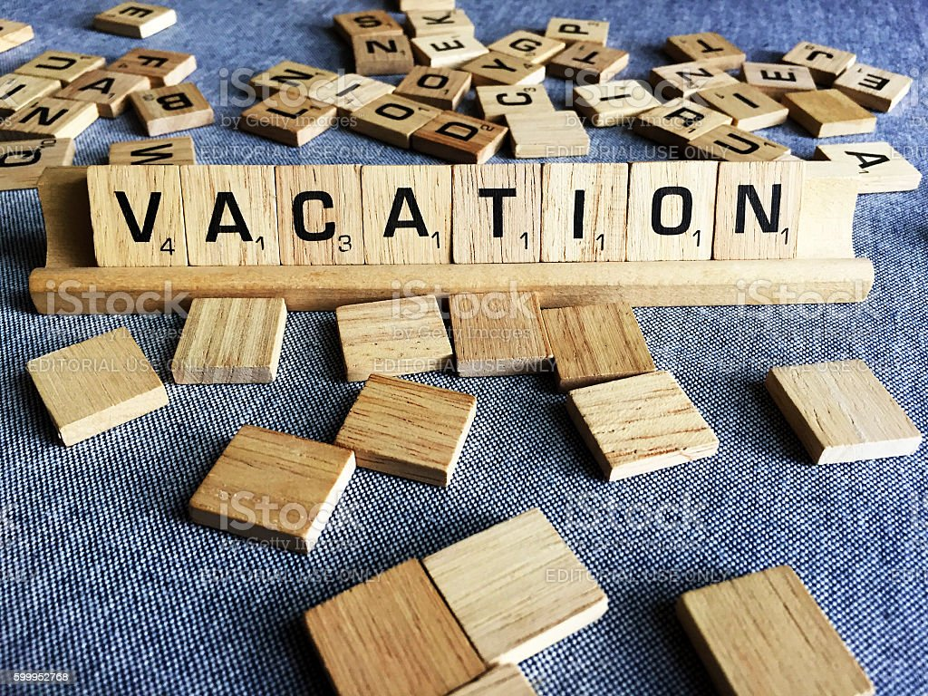 Vacation Spelled with Scrabble Tile Letters stock photo