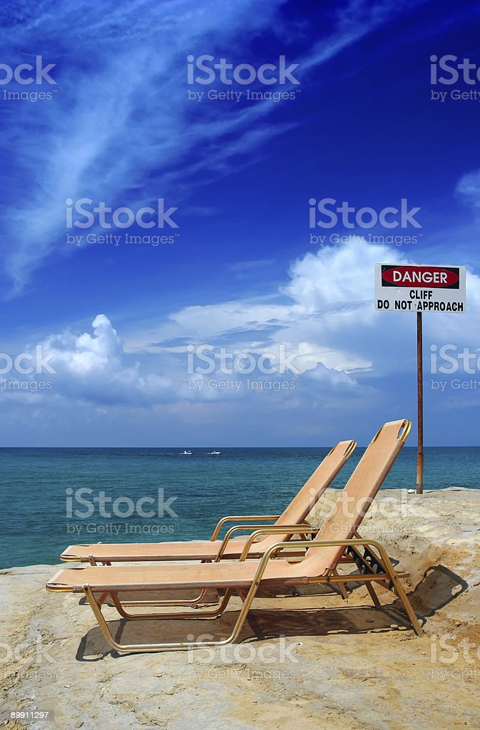 Vacation time, danger clif stock photo