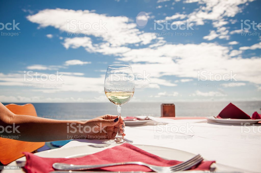 Vacation time.Glass of wine in the hand stock photo