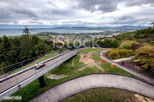 NEW ZEALAND, ROTORUA - NOVEMBER 2017: Man ride on Skyline Rotorua Luge. Skyline Luge is a fun ride. This is a popular fun activity in New Zealand. It is famous among tourist, locals and people.