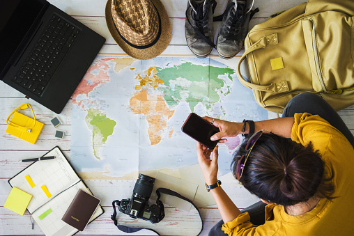 istock Vacation travel planning concept with map. Overhead view of equipment for travelers. Travel concept background, young Asian woman. Travel holiday, summer. 1153172006
