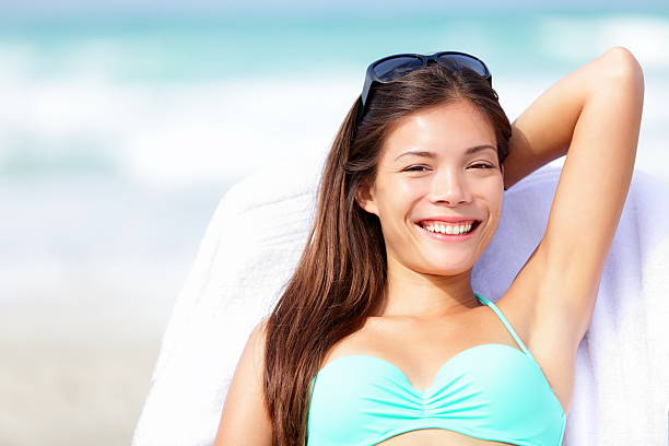 Vacation woman relaxing on sunbed stock photo