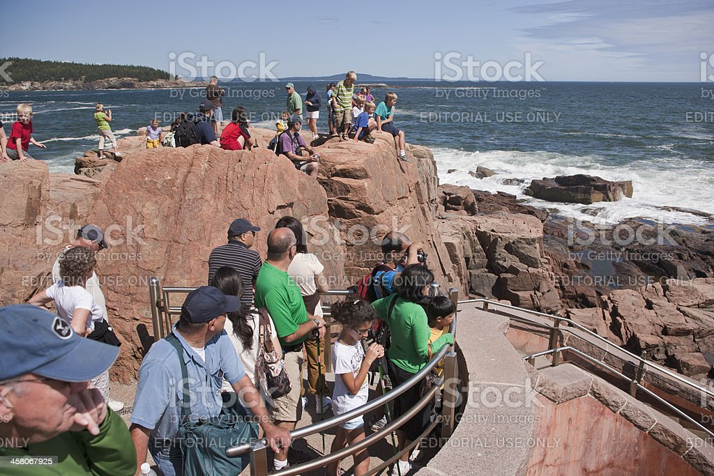 Vacationers at Thunder Hole in Acadia National Park royalty-free stock photo