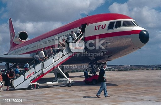 Spain (unfortunately, the exact location is not known), 1979. Vacationers board an LTU flat-rate plane on the Spanish Mediterranean coast.