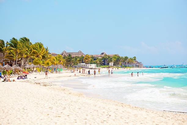 vacationers on playa del carmen beach, riviera maya, yucatan, mexico - playa del carmen stock photos and pictures