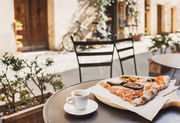 Vacations in Italy. Pizza and coffee in italian cafe stock photo